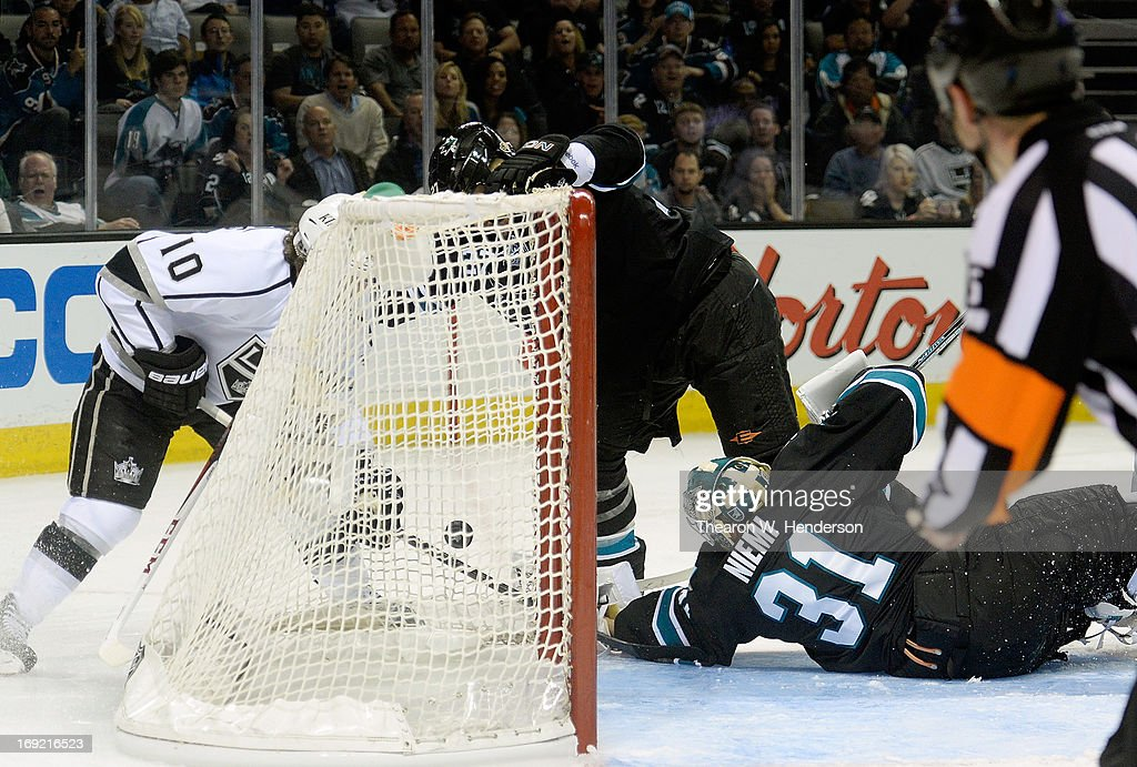 Mike Richards #10 of the Los Angeles Kings gets the puck in the net for a goal, past goalkeeper Antti Niemi #31 of the San Jose Sharks in the third period in Game Four of the Western Conference Semifinals during the 2013 NHL Stanley Cup Playoffs at HP Pavilion on May 21, 2013 in San Jose, California.
