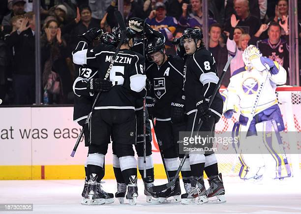 Mike Richards of the Los Angeles Kings is congratulated by Drew Doughty and Jake Muzzin after Richards scored a power play goal in the first period...