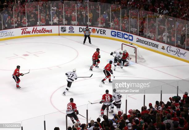 Mike Richards of the Los Angeles Kings scores a goal to tie the score 33 in the third period against goalie Corey Crawford of the Chicago Blackhawks...