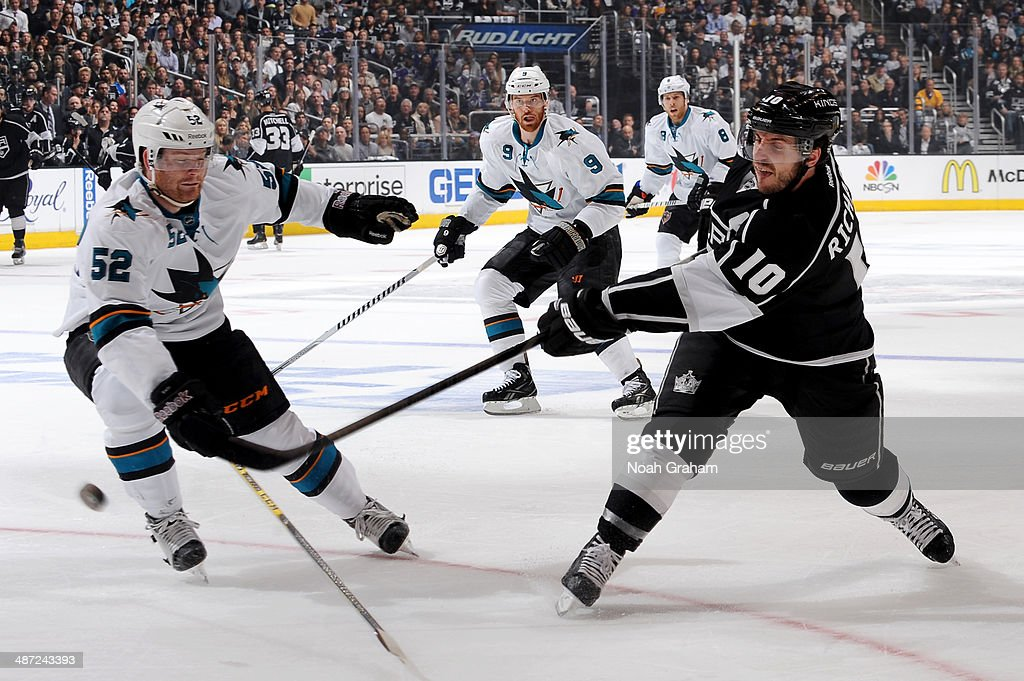 Mike Richards #10 of the Los Angeles Kings shoots the puck against Matt Irwin #52 of the San Jose Sharks in Game Six of the First Round of the 2014 Stanley Cup Playoffs at Staples Center on April 28, 2014 in Los Angeles, California.