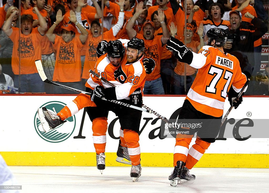 Mike Richards #18 of the Philadelphia Flyers celebrates with teammates Ryan Parent #77 and Claude Giroux #28 after scoring a goal in the first period against Jaroslav Halak #41 of the Montreal Canadiens in Game 5 of the Eastern Conference Finals during the 2010 NHL Stanley Cup Playoffs at Wachovia Center on May 24, 2010 in Philadelphia, Pennsylvania.