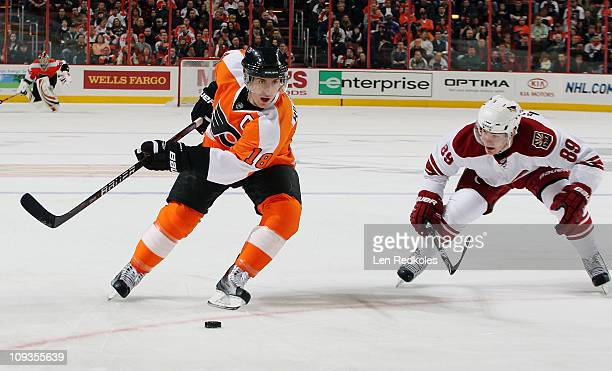 Mike Richards of the Philadelphia Flyers defends the puck against the attack of Mikkel Boedker of the Phoenix Coyotes on February 22 2011 at the...
