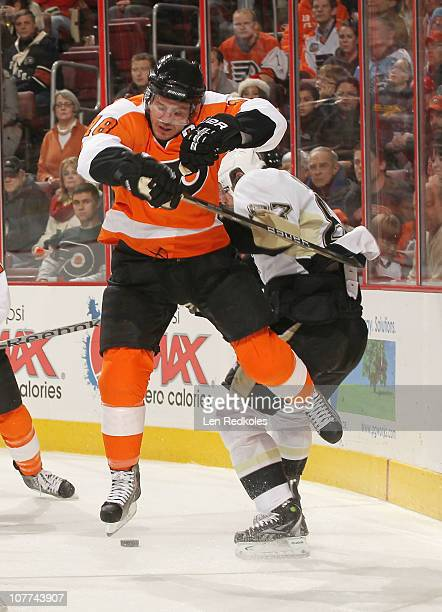 Mike Richards of the Philadelphia Flyers hip checks Sidney Crosby of the Pittsburgh Penguins for control of the puck on December 14 2010 at the Wells...