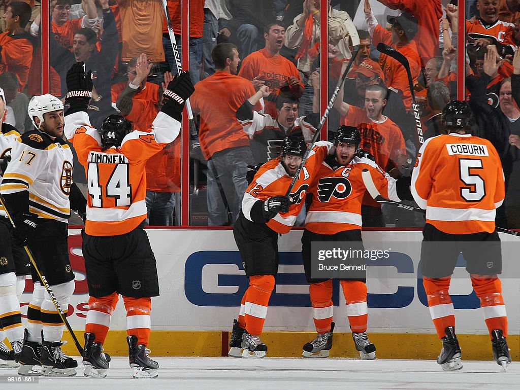 Mike Richards #18 (third from left) of the Philadelphia Flyers scores a first period goal against the Boston Bruins in Game Six of the Eastern Conference Semifinals during the 2010 NHL Stanley Cup Finals at the Wachovia Center on May 12, 2010 in Philadelphia, Pennsylvania. He is joined by (L-R) Kimmo Timonen #44, Simon Gagne #12 and Braydon Coburn #5. The Flyers defeated the Bruins 2-1.