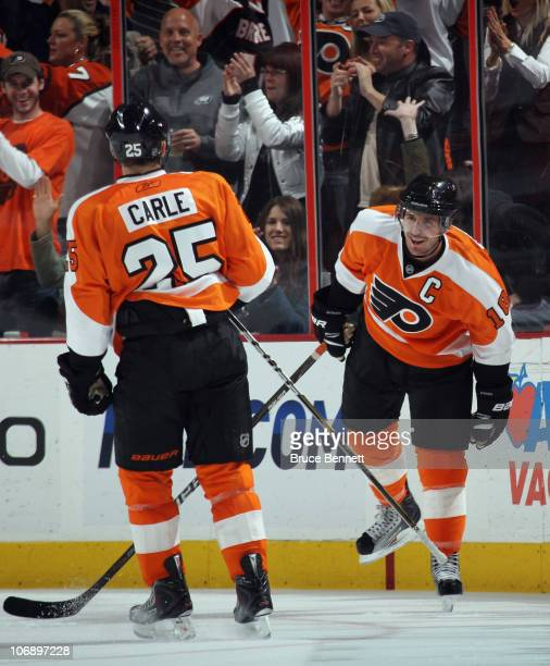 Mike Richards of the Philadelphia Flyers scores at 743 of the third period against the Ottawa Senators and is joined by Matt Carle at the Wells Fargo...
