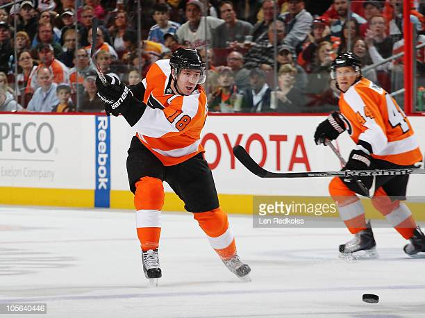 Mike Richards of the Philadelphia Flyers shoots the puck with teammate Kimmo Timonen looking on against the Pittsburgh Penguins on October 16 2010 at...