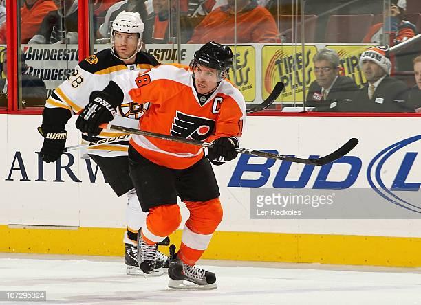 Mike Richards of the Philadelphia Flyers skates against Mark Recchi of the Boston Bruins on December 1 2010 at the Wells Fargo Center in Philadelphia...