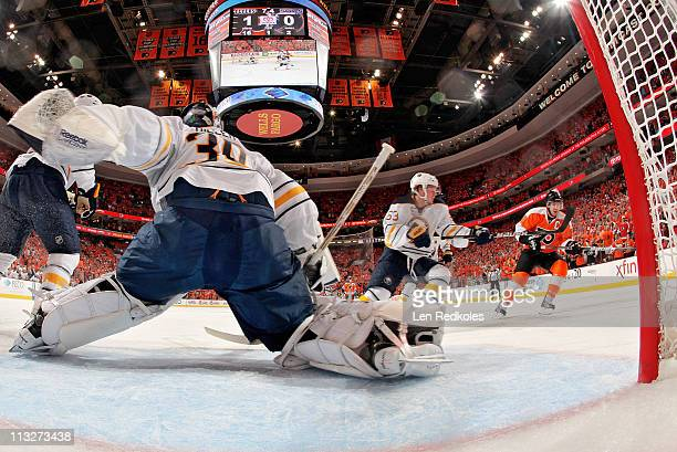Mike Richards of the Philadelphia Flyers skates in for a scoring attempt on Tyler Ennis and ryan Miller of the Buffalo Sabres in Game Seven of the...