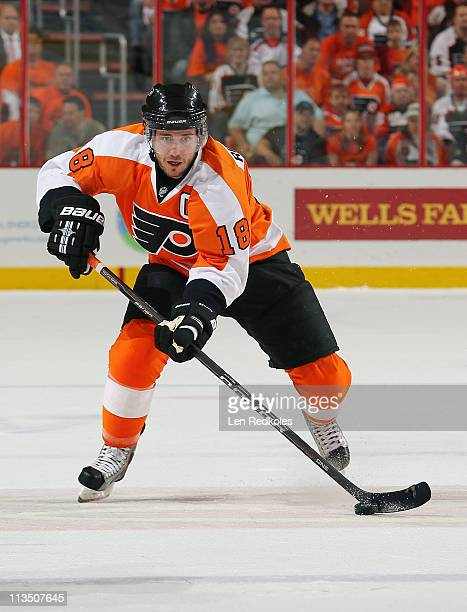 Mike Richards of the Philadelphia Flyers skates with the puck against the Boston Bruins in Game Two of the Eastern Conference Semifinals during the...