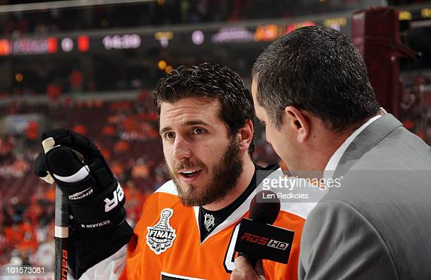 Mike Richards of the Philadelphia Flyers speaks with a member of the media during warmups prior to his game against the Chicago Blackhawks in Game...