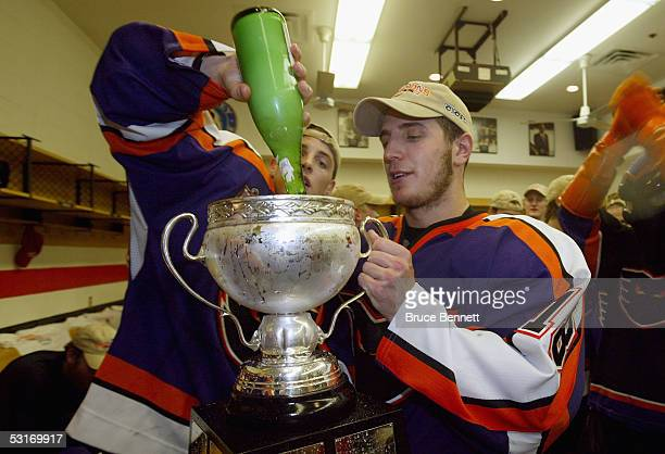 Mike Richards of the Philadelphia Phantoms celebrates in the locker room with the Calder Cup after defeating the Chicago Wolves in the American...