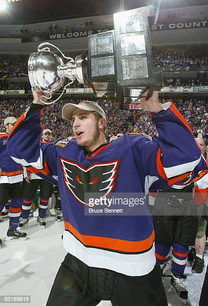 Mike Richards of the Philadelphia Phantoms celebrates on the ice with the Calder Cup after defeating the Chicago Wolves in the American Hockey League...