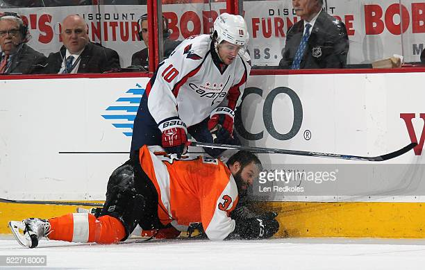 Mike Richards of the Washington Capitals checks Radko Gudas of the Philadelphia Flyers to the ice in Game Four of the Eastern Conference First Round...