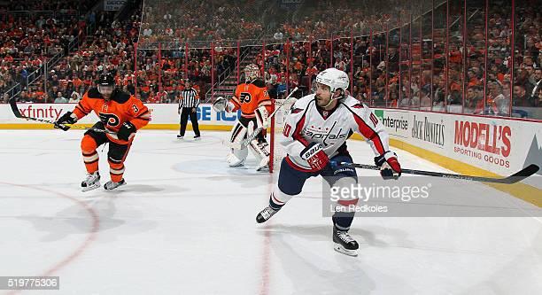 Mike Richards of the Washington Capitals skates alongside Radko Gudas and Steve Mason of the Philadelphia Flyers on March 30 2016 at the Wells Fargo...