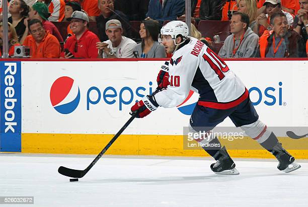 Mike Richards of the Washington Capitals skates the puck against the Philadelphia Flyers in Game Four of the Eastern Conference First Round during...
