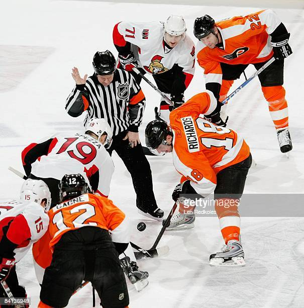 Mike Richards, Simon Gagne and Mike Knuble of the Philadelphia Flyers face off after a loose puck against Dany Heatley, Jason Spezza and Nick Foligno...