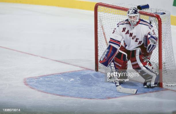Mike Richter, Goaltender for the New York Rangers looks on from behind his mask while tending goal during the NHL Eastern Conference Atlantic...