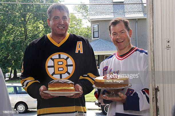 Mike Richter of the New York Rangers and Cam Neely of the Boston Bruins perform on the set of the 2013 Discover NHL Thanksgiving Showdown NBC...