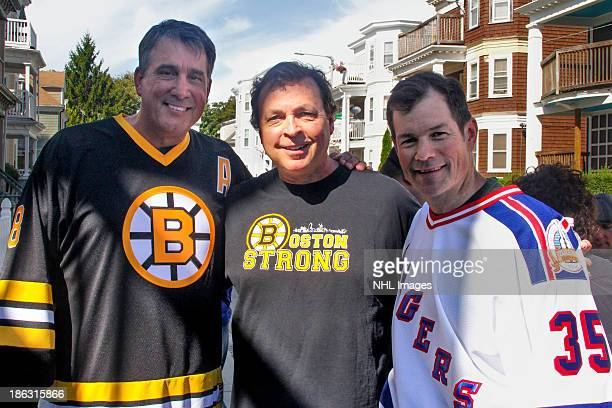 Mike Richter of the New York Rangers and Cam Neely of the Boston Bruins pose with film director Bobby Farrelly on the set of the 2013 Discover NHL...
