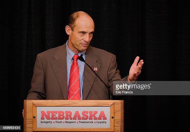 Mike Riley newly hired head football coach at the University of Nebraska talks with members of the media during a press conference inside Memorial...