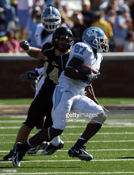 Mike Rinfrette the Linebacker of Wake Forest Demon Deacons tackles Brandon Tate of the UNC Tar Heels during the ACC game at the Groves Stadium, on...