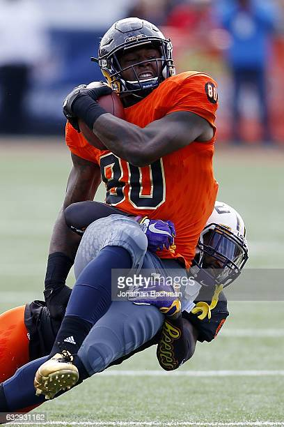 Mike Roberts of the North team catches the ball as Dwayne Thomas of the South team defends during the first half of the Reese's Senior Bowl at the...