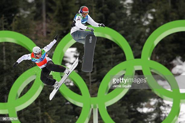 Mike Robertson of Canada and Seth Wescott of the United States compete against each other in the big final heat during the Men's SBX Finals on day 4...
