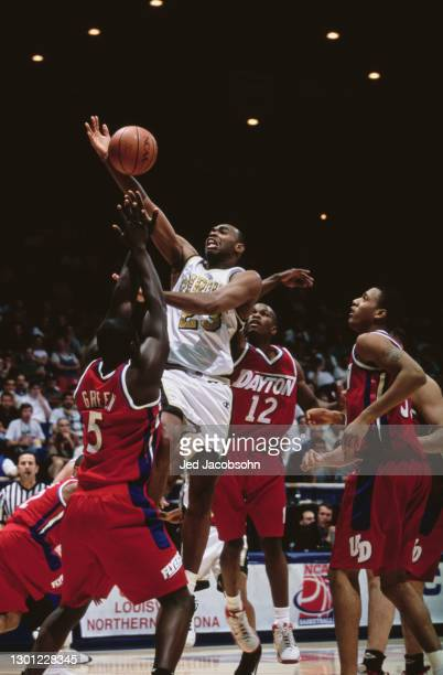Mike Robinson, Forward for the Purdue University Boilermakers jumps above the Dayton Flyers defense to make a one handed lay up during the NCAA...