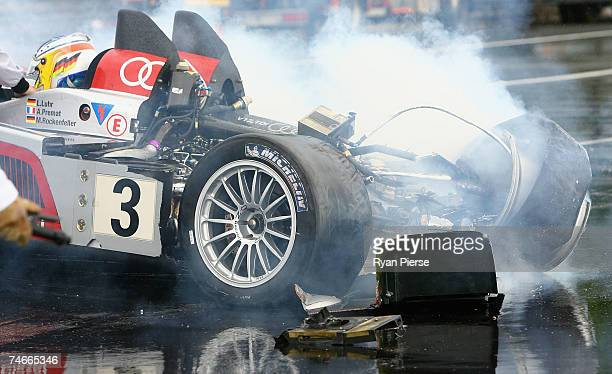 Mike Rockenfeller of Germany and Audi Sport Joest sits in hit car after crashing during the Le Mans 24 Hour race at the Circuit des 24 Heures du Mans...