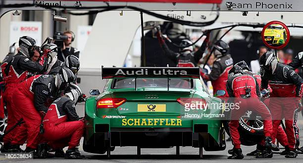 Mike Rockenfeller of Germany and Audi Sport Team Phoenix makes a pit stop during the qualifying for the eighth round of the DTM 2013 German Touring...