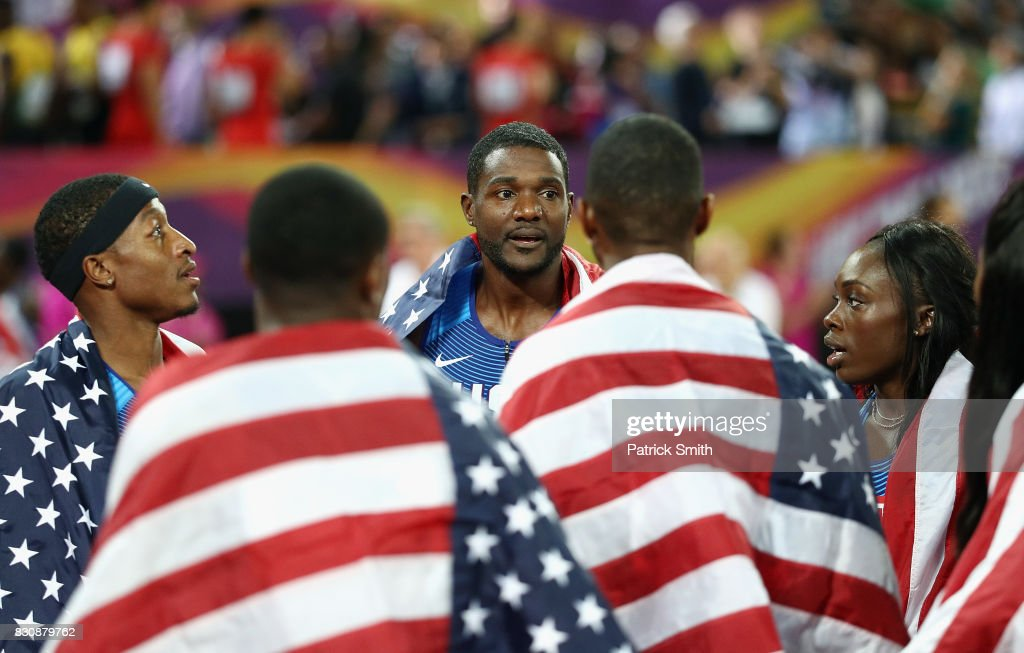 Mike Rodgers, Justin Gatlin and Morolake Akinosun of the United States celebrate after the 4x100 Relay finals during day nine of the 16th IAAF World Athletics Championships London 2017 at The London Stadium on August 12, 2017 in London, United Kingdom.