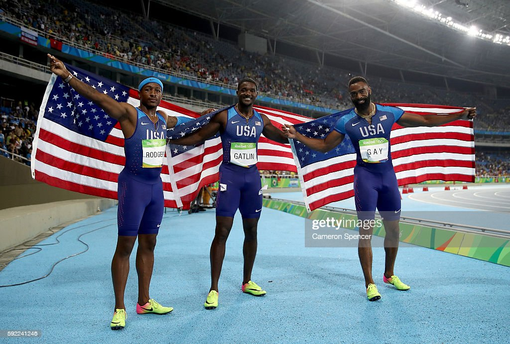 Mike Rodgers, Justin Gatlin and Tyson Gay of the United States celebrate prior to being disqualified after the Men's 4 x 100m Relay Final on Day 14 of the Rio 2016 Olympic Games at the Olympic Stadium on August 19, 2016 in Rio de Janeiro, Brazil.