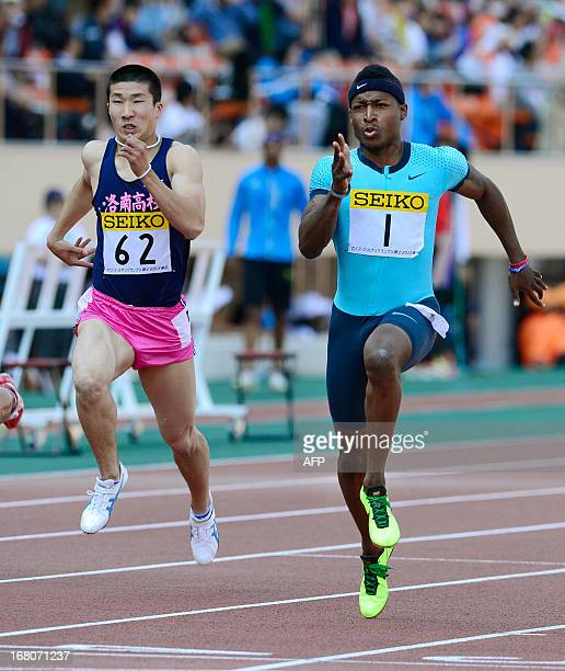 Mike Rodgers of the US runs beside Japanese teenager Yoshihide Kiryu in the men's 100 metre race during the Seiko Golden Grand Prix in Tokyo on May...