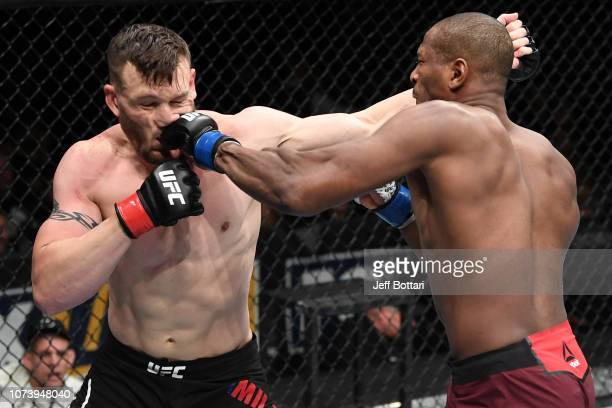 Mike Rodriguez punches Adam Milstead in their light heavyweight bout during the UFC Fight Night event at Fiserv Forum on December 15, 2018 in...