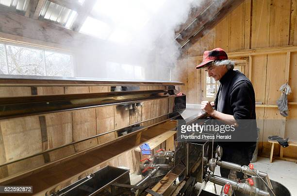 Mike Romanyshyn of Temple Tappers watches over birch syrup in an evaporator Friday April 15 2016