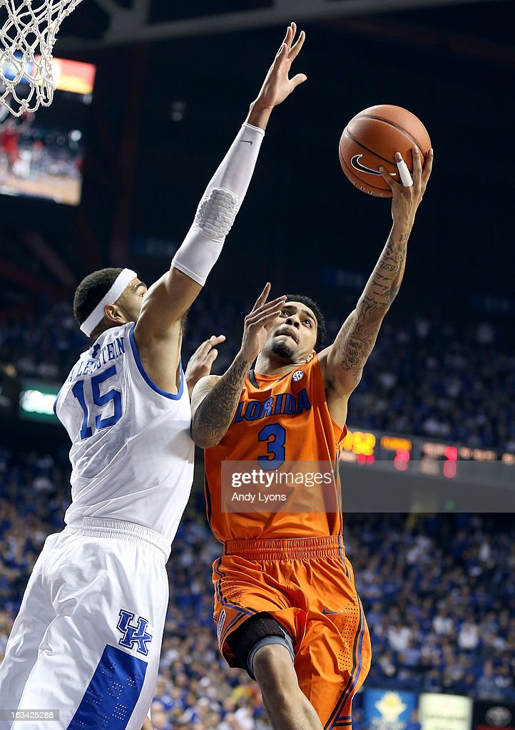 Mike Rosario #3 of the Florida Gators shoots the ball while defended by Willie Cauley-Stien #15 of the Kentucky Wildcats during the game at Rupp Arena on March 9, 2013 in Lexington, Kentucky.