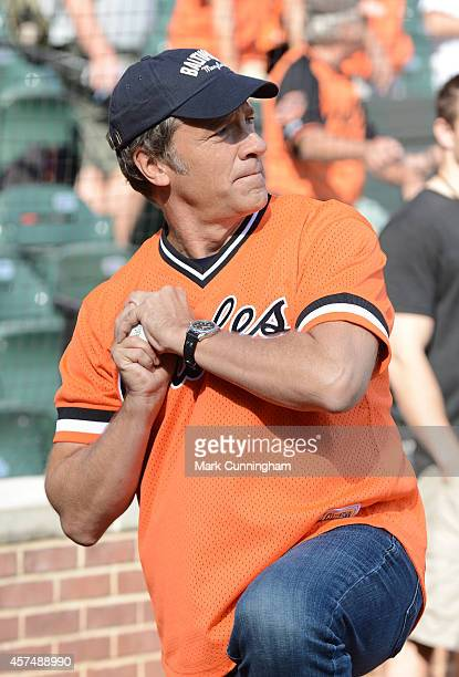 Mike Rowe host of CNN's 'Somebody's Gotta Do It' looks on during batting practice prior to Game Two of the American League Division Series between...