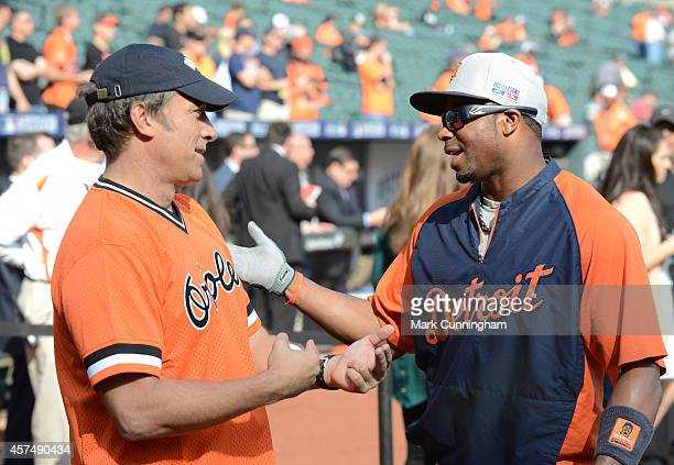 Mike Rowe host of CNN's 'Somebody's Gotta Do It' talks with Rajai Davis of the Detroit Tigers during batting practice prior to Game Two of the...