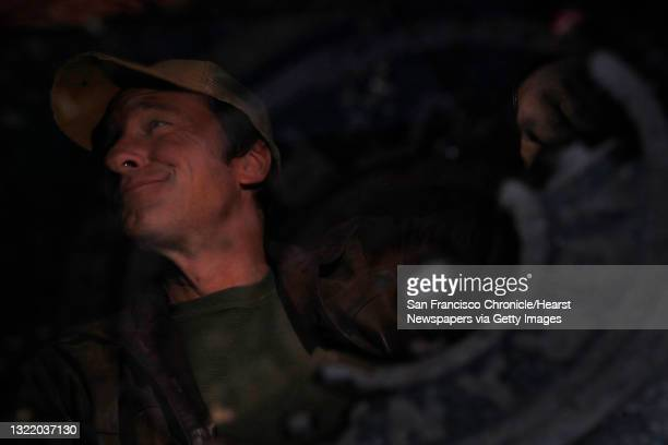 """Mike Rowe, host of """"Dirty Jobs"""" on the Discovery channel is seen reflected in a puddle next to a drain on Monday, November 29, 2010 in San Francisco,..."""