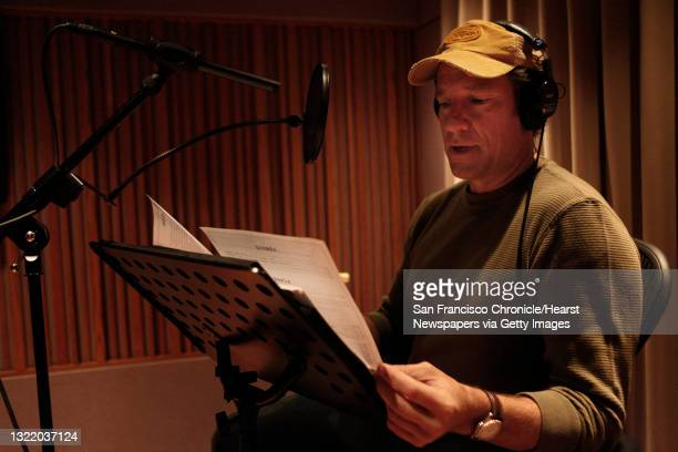 """Mike Rowe, host of """"Dirty Jobs"""" on the Discovery channel, looks over papers while recording voiceovers on Monday, November 29, 2010 in San Francisco,..."""