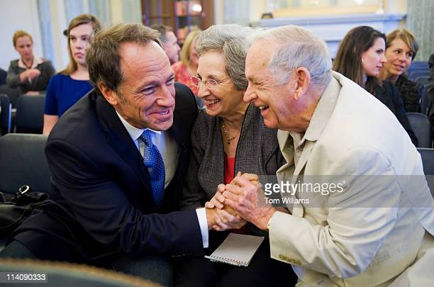 Mike Rowe left producer and host of Discovery Channel's 'Dirty Jobs' shares a laugh with his parents John and Peggy Rowe of Perry Hall Md before Mike...
