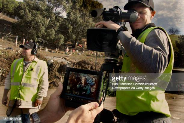 """Mike Rowe, of San Francisco, host of the Discovery channel's """"Dirty Jobs,"""" on the hand held monitor at Norcal Waste shooting a segment. Field..."""