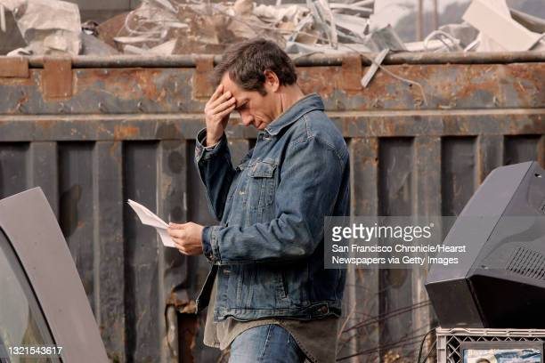 """Mike Rowe, of San Francisco, host of the Discovery channel's """"Dirty Jobs,"""" at Norcal Waste studying lines for a segment. Dirty Jobs grew out of a..."""