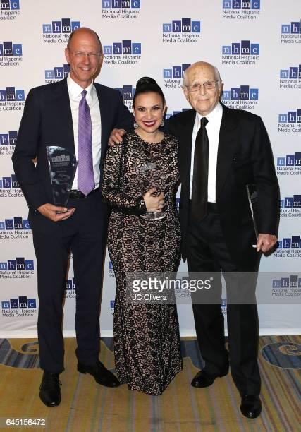 Mike Royce Gloria Calderon Kellett and writer/producer Norman Lear attend the 20th Annual National Hispanic Media Coalition Impact Awards Gala at...