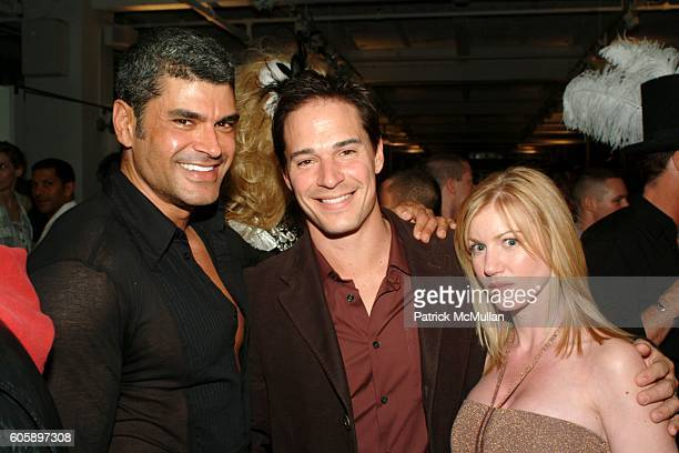 Mike Ruiz Tracy James and Peel James attend AMANDA LEPORE DOLL cocktail party at Jeffrey on April 11 2006 in New York City