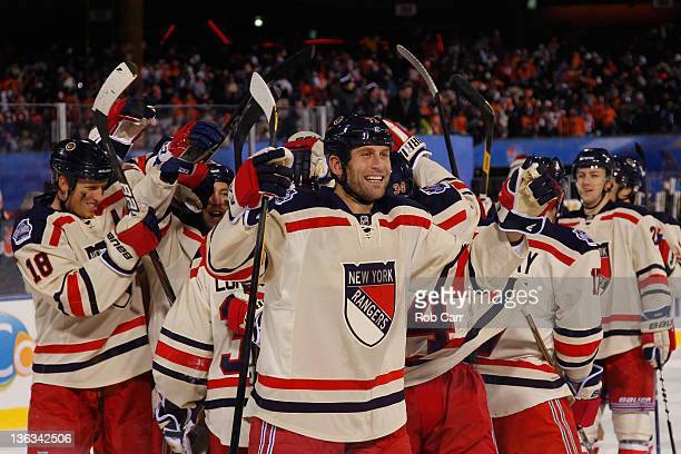 Mike Rupp and the New York Rangers celebrate after defeating the Philadelphia Flyers by a score of 32 during the 2012 Bridgestone NHL Winter Classic...
