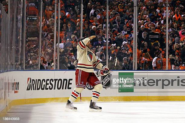 Mike Rupp of the New York Rangers salutes after scoring a goal in the second period against the Philadelphia Flyers during the 2012 Bridgestone NHL...