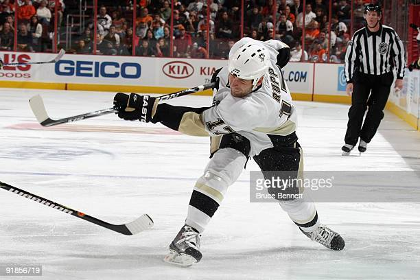 Mike Rupp of the Pittsburgh Penguins shoots during the game against the Philadelphia Flyers at the Wachovia Center on October 8 2009 in Philadelphia...
