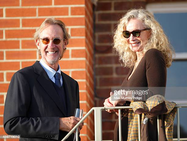 Mike Rutherford and Angie Rutherford watch the racing as they attend the Hennessy Gold Cup race meeting at Newbury Racecourse on November 29 2014 in...