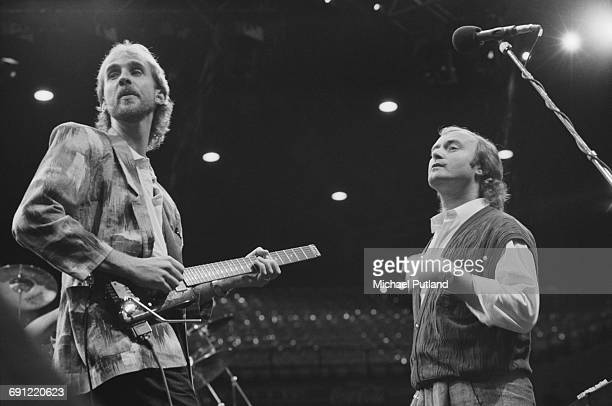 Mike Rutherford and Phil Collins performing with English rock group Genesis at the Rosemont Horizon Rosemont Illinois during the band's Invisible...